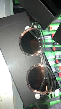 silver-colored framed sunglasses 786 km