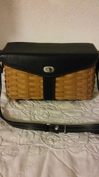brown wicker basket with black leather cover