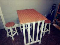 brown and white wooden table 506 km