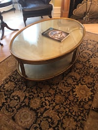 Round brown wooden framed glass top coffee table Westmount, H3Y 2S4