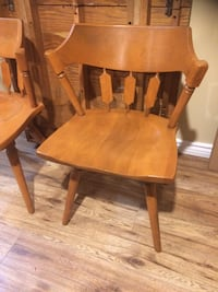 8 brown wooden chairs