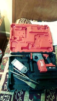 red and black Milwaukee cordless power tool with c Pleasant Hill