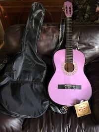 Beginner purple guitar with extra strings and case  Surrey, V3T 2S3