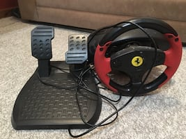 black and red racing wheel controller