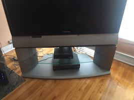 TV Stand with glass middle. Excellent condition