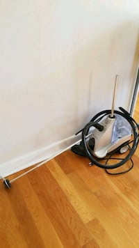 black and gray canister vacuum cleaner 130 mi