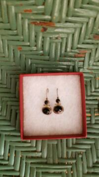 gold-colored and black earrings Reno, 89502