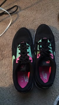 pair of black-and-pink Nike cleats Nashville, 37013