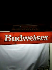 red and white Budweiser signage
