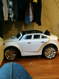 white and black ride on toy car