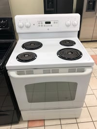 White Ge self cleaning oven electric stove it works great 100 days warranty Baltimore, 21231