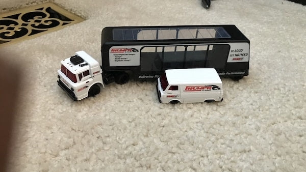 white and black tow truck toy