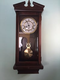 brown wooden pendulum clock