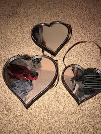 three brown steel heart shaped frames mirrors