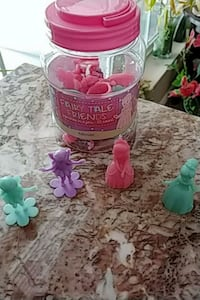 Fairy tale plastic figurines in a jar. MPU Commerce City, 80022