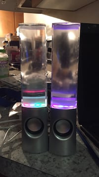 Two black and gray tower speakers