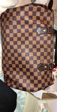Authentic Louis Vuitton Small Duffle - Great Condition - Comes with key for lock - Price IS negotiable! - Send me a message to chat!! Calgary, T3E