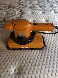 orange and black corded power tool Calgary, T2A 0X2