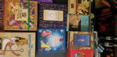 Variety of tarot & oracle cards, books, and astrology books