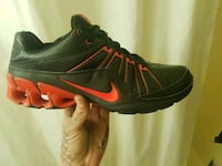 red and black Nike lace-up sneaker 3151 km