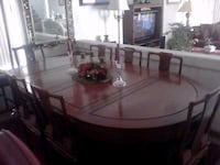 round brown wooden table with chairs Las Vegas, 89113
