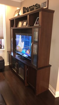 Brown wooden tv unit. Sold either with or without  TV.  Toronto, M6E 4K4