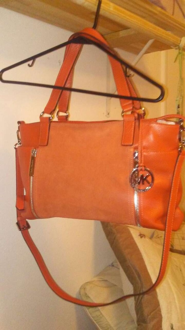 d9e5378a3f Used women's orange Michael Kors leather tote purse for sale in ...