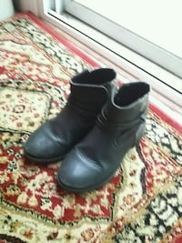 pair of black leather boots Alexandria