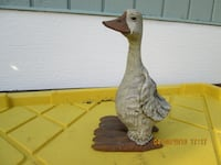 white and brown duck figurine Tacoma