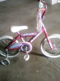 toddler's pink and white bicycle 2395 mi