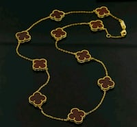 gold-colored necklace and earrings 535 km