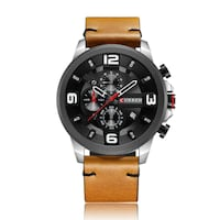 round black chronograph watch with brown leather strap Montreal, QC H2M 1P6, Canada