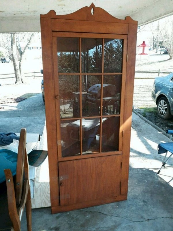"""brown wooden framed glass display cabinet. 78""""x34"""""""