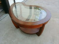 round brown wooden framed glass top table Commerce City, 80022