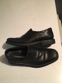 pair of black Clarks leather dress shoes