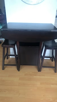Dark wooden table and stools Vancouver, V6G 2A1