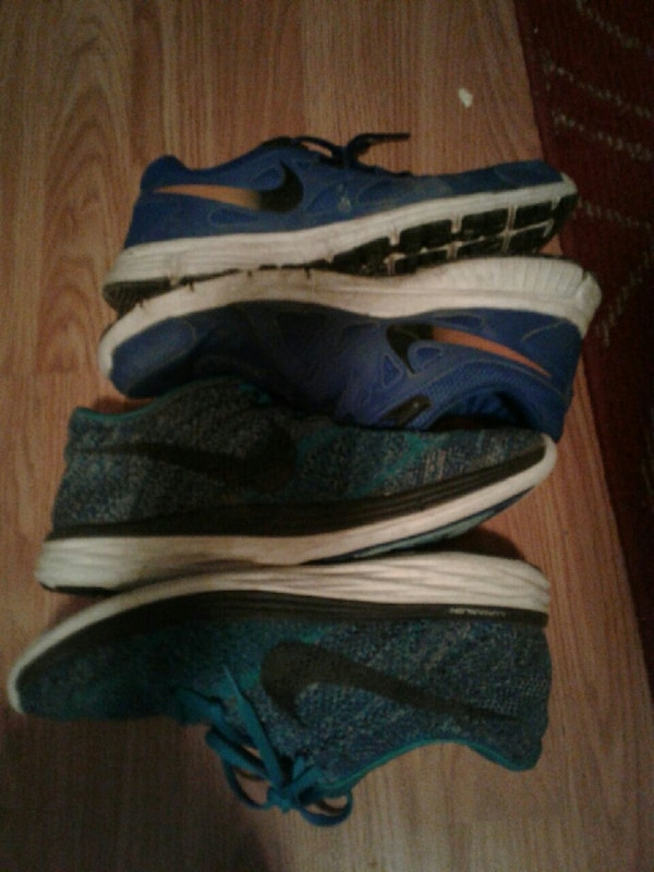 four unpaired Nike low-top sneakers