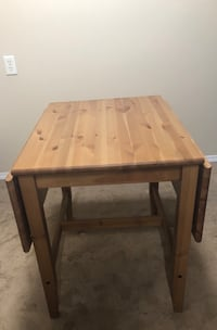 rectangular brown wooden table with two chairs Edmonton, T5K 0G1