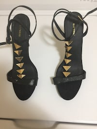 Used Express Gold and Black sandals  Woodstock