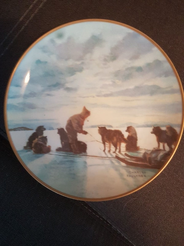 man and pack of wolves commemorative plate