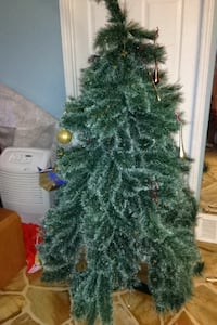 Green christmas tree with white ends