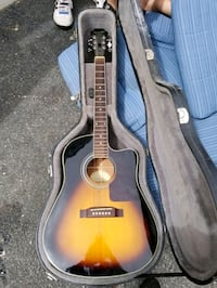 brown acoustic guitar in case Woonsocket, 02895