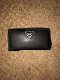 Like new black leather guess wallet, used only a little.