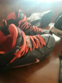pair of black-and-red Nike basketball shoes Troy, 12180