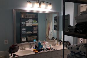 Double vanity mirror and light