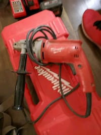 red and black Milwaukee corded power drill 1958 km