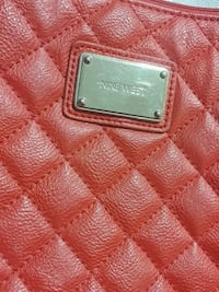 red and gray leather bag 3749 km