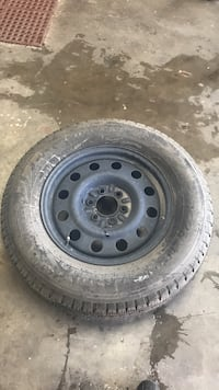 Black bullet-hole wheel with tire