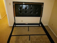Bed, queen size with nice leather headboard Gresham