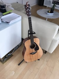 dreadnought brown acoustic guitar with guitar stand